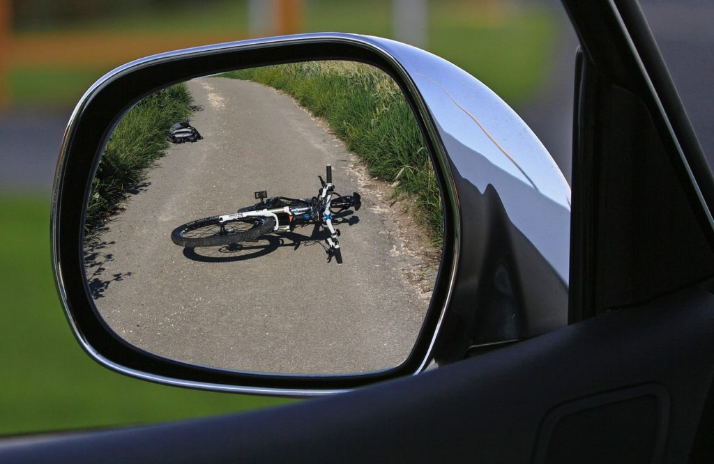 Image of a Fallen Bicycle in a Side Mirror - Witnessing an Accident in Israel